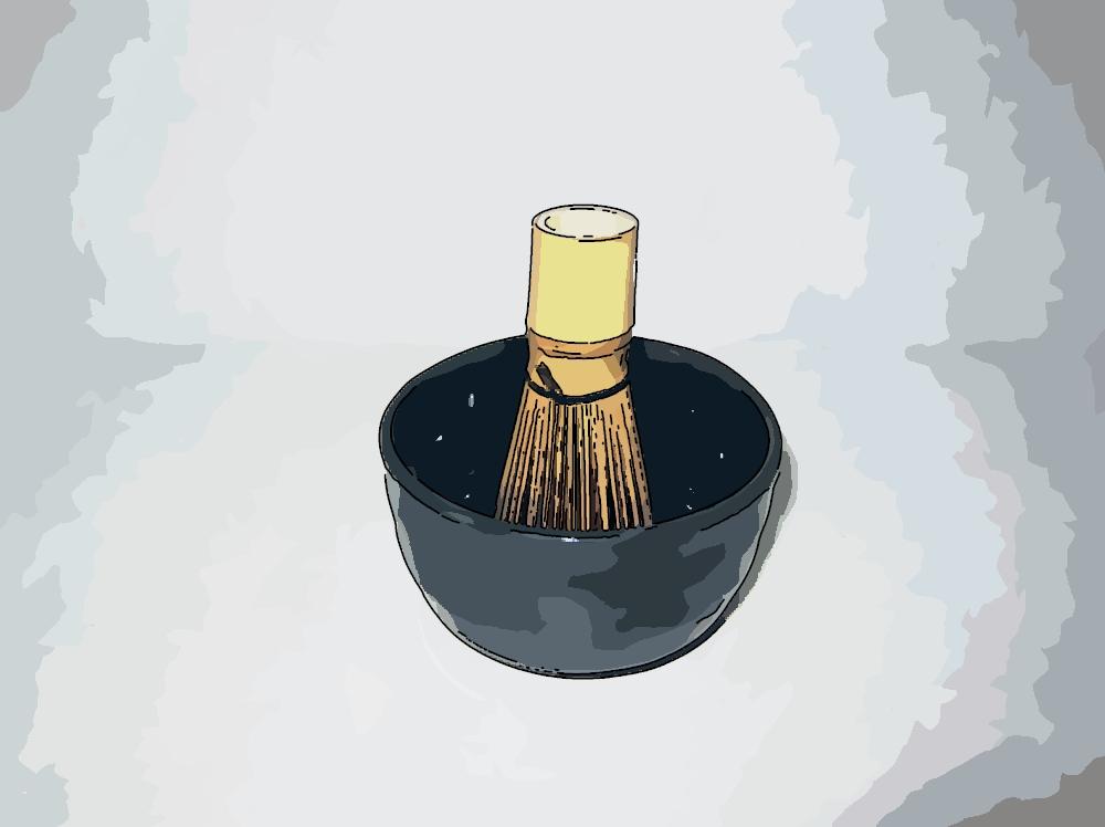 Bambusbesen (Chasen) in schwarzer Matcha Schale (Chawan)